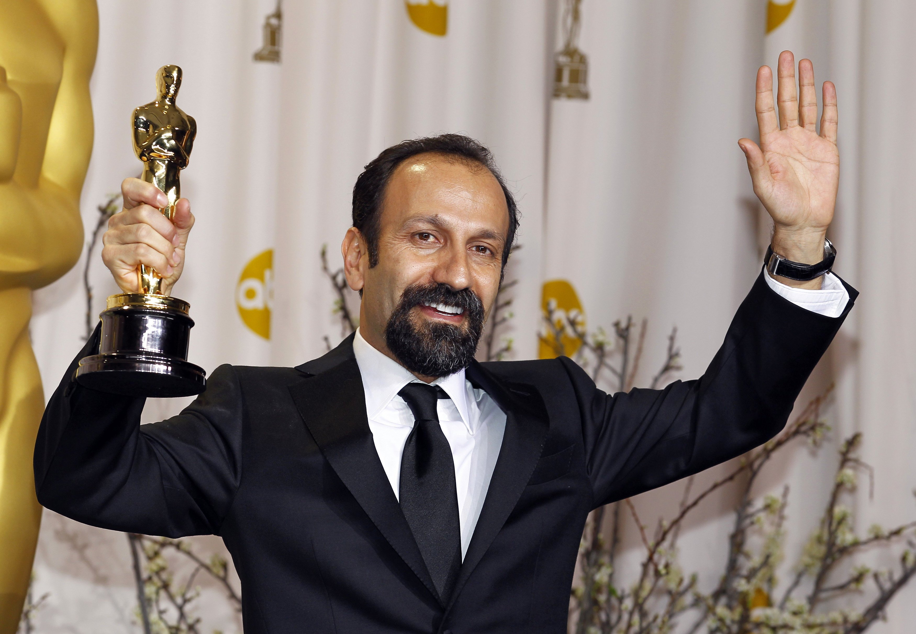 "Asghar Farhadi, director of Iranian film ""A Separation"", poses with his award for Best Foreign Language film during the 84th Academy Awards in Hollywood"